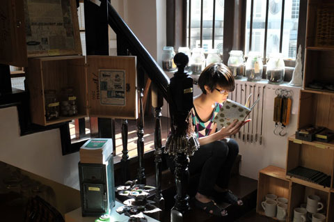 Staff member at 'Books Actually' on Club Street in Singapore. 2010 photograph by Geraldine Kan.