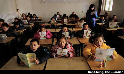 Migrant Chinese children in a private school in Beijing. Photography by Dan Chung of The Guardian.