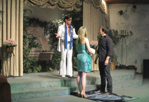 Emma and Denis Merkas of Melbourne renew their wedding vows with Elvis at the Viva Las Vegas Wedding Chapel, Blog World Expo, October 2010.