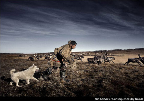 Yuri Kozyrev photograph of a reindeer herder from 'The Yamal Peninsula: A Land and People Threatened,' one documentary in the 'Consequences by NOOR' exhibition.